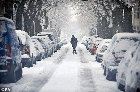 Lone pedestrian on a snow covered street. Source: http://www.dailymail.co.uk/news/article-1138401/Britain-blanketed-snow-theres-grit-trains-grind-halt---Transport-Secretary-says-Dont-whinge.html
