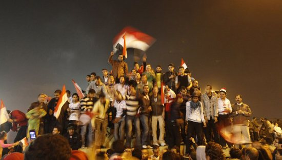 Protesters in Egypt. Source: Protesters in Egypt. Source: http://en.rian.ru/trend/domino_effect_arab_countries_2011/