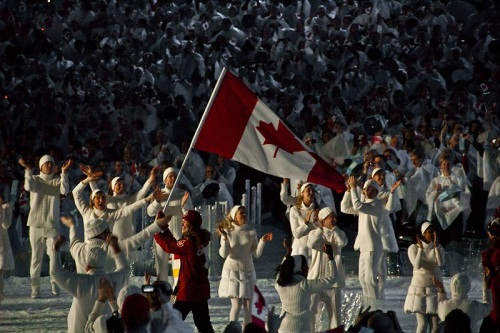 Clara Hughes with the Canadian flag. Source: http://commons.wikimedia.org/wiki/File:Clara_Hughes_with_Canadian_flag.jpg