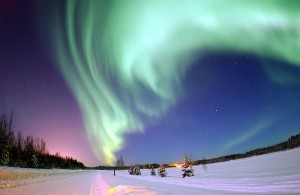 Eielson Air Force Base, Alaska — The Aurora Borealis, or Northern Lights, shines above Bear Lake. Source: Wikipedia